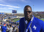 In this Saturday, Nov. 2, 2019, photo, Jermaine Birdow stands at Falcon Stadium, where he watched his son, Air Force running back Taven Birdow, and teammates play Army in an NCAA college football game at Air Force Academy, Colo. Jermaine Birdow, who was released from jail last November after serving a long sentence stemming from a 2001 home invasion, was able to see for the first time in person his son play in a game. (AP Photo/Pat Graham)
