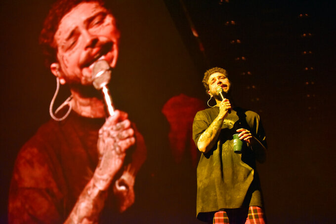 """Post Malone performs during the """"Runaway Tour,"""" at the Allstate Arena, Tuesday, Feb. 11, 2020, in Rosemont, Ill. (Photo by Rob Grabowski/Invision/AP)"""