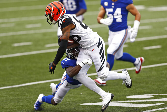 New York Giants cornerback Isaac Yiadom (27) tackles Cincinnati Bengals wide receiver Tee Higgins (85) during the second half of NFL football game, Sunday, Nov. 29, 2020, in Cincinnati. (AP Photo/Aaron Doster)
