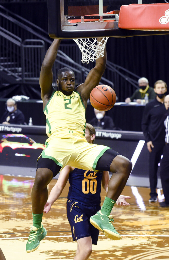 Oregon forward Eugene Omoruyi (2) dunks against California during the second half of an NCAA college basketball game Thursday, Dec. 31, 2020, in Eugene, Ore. (AP Photo/Andy Nelson)