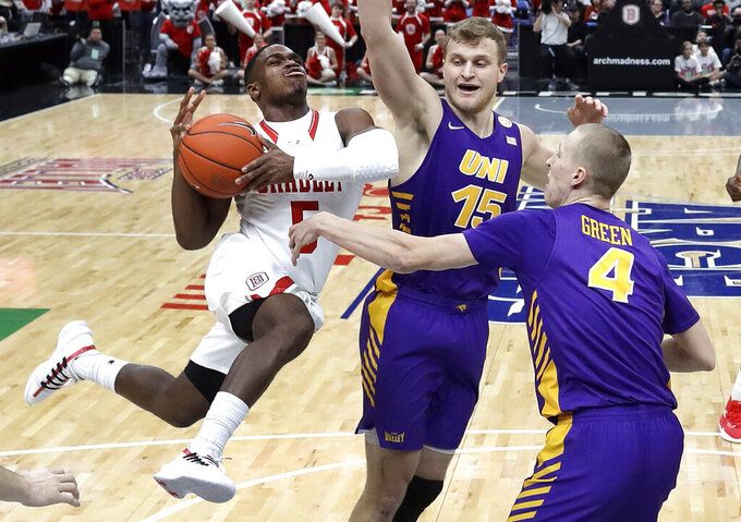 Bradley's Darrell Brown, left, heads to the basket as Northern Iowa's Justin Dahl (15) and AJ Green (4) defend during the first half of an NCAA college basketball game in the championship of the Missouri Valley Conference tournament, Sunday, March 10, 2019, in St. Louis. (AP Photo/Jeff Roberson)