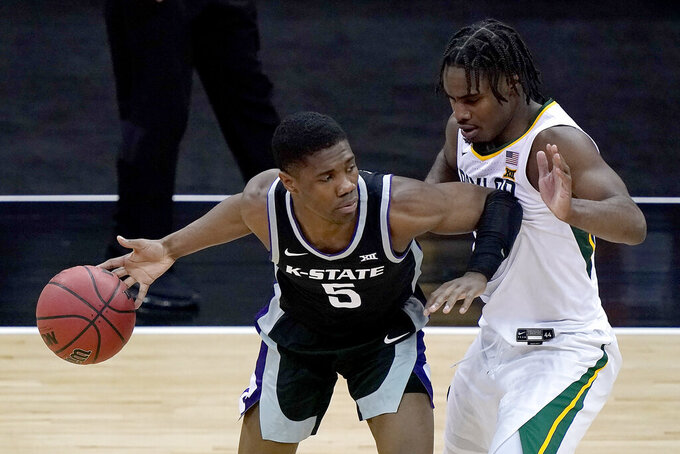 Kansas State's Selton Miguel (5) is pressured by Baylor's Davion Mitchell during the first half of an NCAA college basketball game in the second round of the Big 12 Conference tournament in Kansas City, Mo., Thursday, March 11, 2021. (AP Photo/Charlie Riedel)