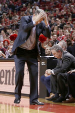 Northwestern coach Chris Collins, left, reacts after a turnover during the second half of an NCAA college basketball game against Nebraska in Lincoln, Neb., Saturday, Feb. 16, 2019.  (AP Photo/Nati Harnik)