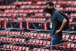 Boston Red Sox chief baseball officer Chaim Bloom wears a protective mask while watching practice at Fenway Park on Thursday, July 9, 2020, in Boston. (AP Photo/Charles Krupa)