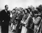 FILE - In this March 10, 1957 file photo, Britain's Prince Philip is greeted by some of the students of St. Mary's College, in Cheltenham, England, as he left the playing fields of St. Paul's College  (AP Photo/File)