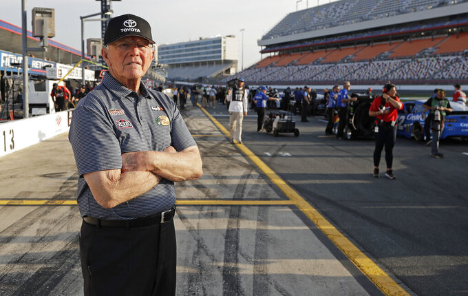 FILE - In this May 23, 2019, file photo, Team owner Joe Gibbs looks down pit road before qualifications for the NASCAR Cup Series auto race at Charlotte Motor Speedway in Concord, N.C. NASCAR's season officially opens Sunday, Feb. 16, 2020, with the Daytona 500 at Daytona International Speedway. (AP Photo/Chuck Burton, File)