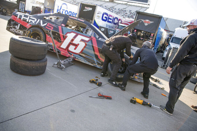 Car for Brennan Poole (15) gets worked on in the garage area during a NASCAR Cup Series auto race at the Martinsville Speedway in Martinsville, Va., Sunday, Nov.1, 2020. (AP Photo/Lee Luther Jr.)