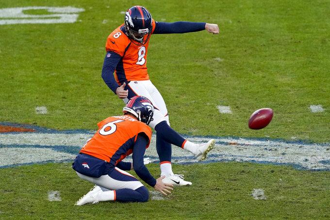 Denver Broncos kicker Brandon McManus (8) kicks a field goal as punter Sam Martin (6) holds during the second half of an NFL football game against the New Orleans Saints, Sunday, Nov. 29, 2020, in Denver. (AP Photo/Jack Dempsey)