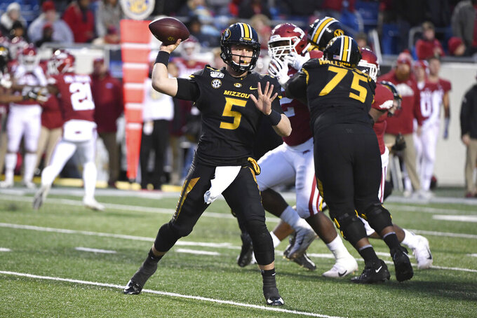 Missouri quarterback Taylor Powell drops back to pass against Arkansas during the second half of an NCAA college football game Friday, Nov. 29, 2019, in Little Rock, Ark. (AP Photo/Michael Woods)
