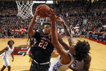 Texas Tech's TJ Holyfield (22) rebounds the ball around Kentucky's Nick Richards (4) during the second half of an NCAA college basketball game Saturday, Jan. 25, 2020, in Lubbock, Texas. (AP Photo/Brad Tollefson)