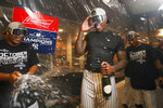 New York Yankees relief pitcher Aroldis Chapman celebrates after defeating the Los Angeles Angels and clinching the AL East baseball title Thursday, Sept. 19, 2019, in New York. (AP Photo/Mary Altaffer)