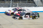 Denny Hamlin (11) passes Austin Dillon (3) for the lead during a NASCAR Cup Series auto race at Dover International Speedway, Saturday, Aug. 22, 2020, in Dover, Del. (AP Photo/Jason Minto)