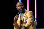 Charles Woodson answers a question, as members of the Pro Football Hall of Fame Class of 2021, participate in an enshrinees' roundtable in Canton, Ohio, Sunday, Aug. 8, 2021. (AP Photo/Gene J. Puskar)