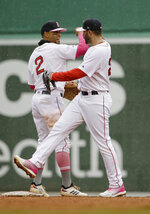 Boston Red Sox's Xander Bogaerts, left, and J.D. Martinez, right celebrate their win over the Seattle Mariners in a baseball game at Fenway Park, Sunday, May 12, 2019, in Boston. 5(AP Photo/Steven Senne)