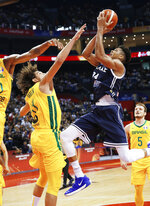Giannis Antetokounmpo of Greece puts up a shot over Anderson Varejao of Brazil during their group stage match in the FIBA Basketball World Cup in Nanjing in eastern China's Jiangsu province, Tuesday, Sept. 3, 2019. (Chinatopix via AP)
