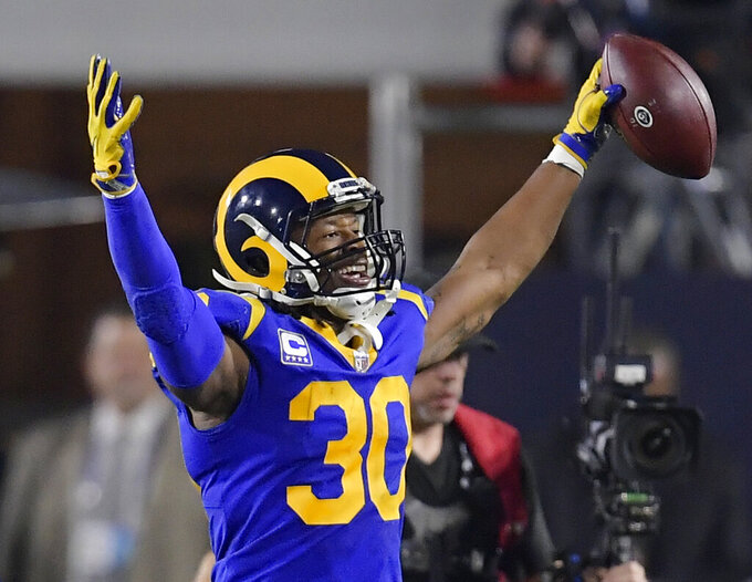 FILE - In this Saturday, Jan. 12, 2019, file photo, Los Angeles Rams running back Todd Gurley celebrates after scoring against the Dallas Cowboys during the first half in an NFL divisional football playoff game in Los Angeles. Gurley loved to attend the Super Bowl as a fan the past few years. Now that he finally gets to play in it with the Rams, the star running back doesn't even care if he's sharing carries with C.J. Anderson.  (AP Photo/Mark J. Terrill, File)