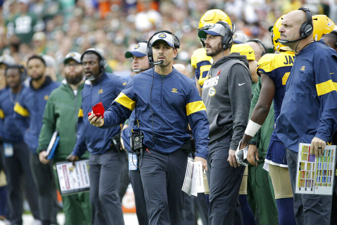 Green Bay Packers head coach Matt LaFleur considers throwing a challenge flag during the second half of an NFL football game against the Denver Broncos, Sunday, Sept. 22, 2019, in Green Bay, Wis. (AP Photo/Mike Roemer)
