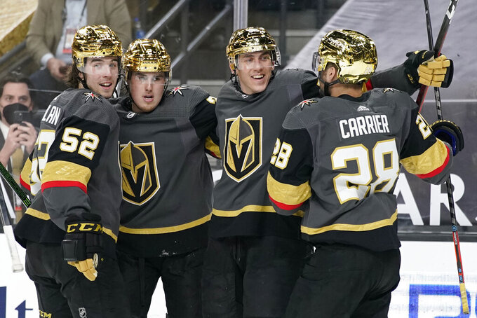 Vegas Golden Knights celebrate after left wing Tomas Nosek, second from right, scored against the Los Angeles Kings during the second period of an NHL hockey game Monday, March 29, 2021, in Las Vegas. (AP Photo/John Locher)