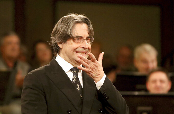 FILE - In this Dec. 30, 2017 file photo, Italian Maestro Riccardo Muti conducts the Vienna Philharmonic Orchestra during a rehearsal for the traditional New Year's concert at the golden hall of Vienna's Musikverein. With a purposeful nod and flick of his baton, the 79-year-old conductor on Sunday, May 9, 2021, ended what has been an unexpectedly long silence in Italian theaters, enrapturing a socially distanced and masked audience with the Vienna Philharmonic Orchestra's first live performances since fall, two evening concerts of Mendelssohn, Schumann and Brahms, in his adopted hometown of Ravenna. (AP Photo/Ronald Zak, file)