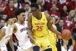 Maryland's Jalen Smith (25) is defended by Indiana's Justin Smith (3) during the first half of an NCAA college basketball game, Sunday, Jan. 26, 2020, in Bloomington, Ind. (AP Photo/Darron Cummings)