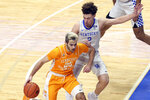 Tennessee's Santiago Vescovi (25) drives while defended by Kentucky's Devin Askew (2) during the first half of an NCAA college basketball game in Lexington, Ky., Saturday, Feb. 6, 2021. (AP Photo/James Crisp)