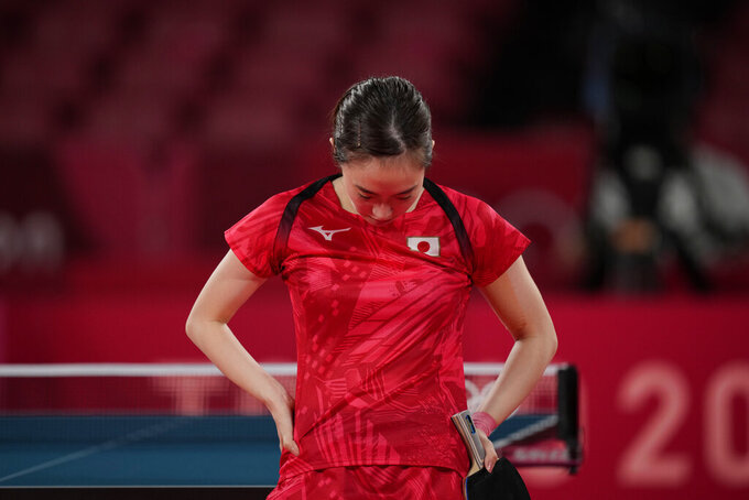 Japan's Kasumi Ishikawa reacts during the table tennis women's singles quarterfinal match against Singapore's Yu Mengyu at the 2020 Summer Olympics, Wednesday, July 28, 2021, in Tokyo. (AP Photo/Kin Cheung)