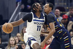 Minnesota Timberwolves' Naz Reid, left, drives against Cleveland Cavaliers' John Henson in the first half of an NBA basketball game, Sunday, Jan. 5, 2020, in Cleveland. (AP Photo/Tony Dejak)