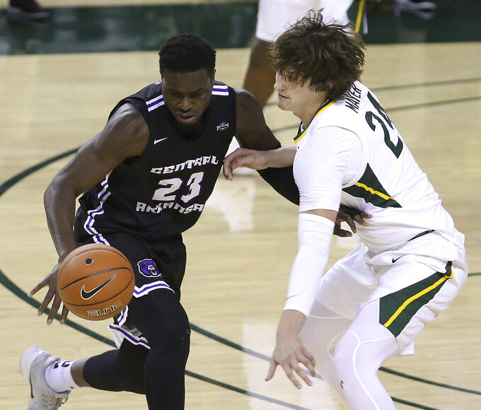 Baylor guard Matthew Mayer (24) strips the ball from Central Arkansas forward Samson George (23) in the second half of an NCAA college basketball game, Tuesday, Dec. 29, 2020, in Waco, Texas. (AP Photo/ Jerry Larson)