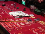 This June 24, 2016 photo shows cash, chips and dice on a craps table during a game at the Golden Nugget casino in Atlantic City, N.J. On June 16, 2020, the American Gaming Association, the casino industry's national trade group, called on state gambling regulators to make it easier for gamblers to use cashless betting options during the coronavirus outbreak. (AP Photo/Wayne Parry)
