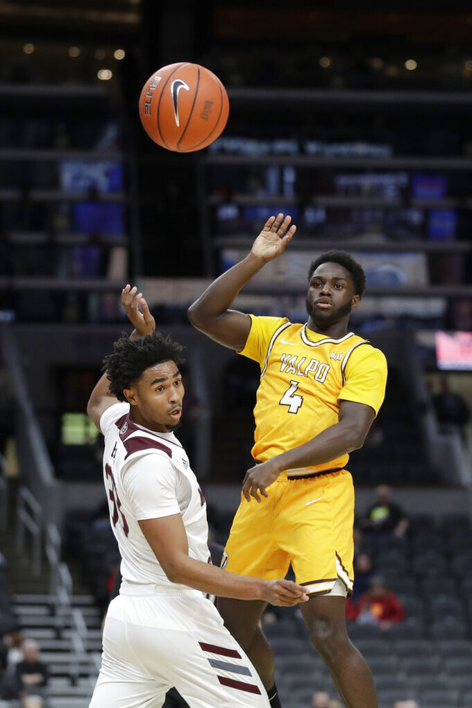 Valparaiso's Daniel Sackey (4) passes over Missouri State's Josh Hall during the first half of an NCAA college basketball game in the semifinal round of the Missouri Valley Conference men's tournament Saturday, March 7, 2020, in St. Louis. (AP Photo/Jeff Roberson)