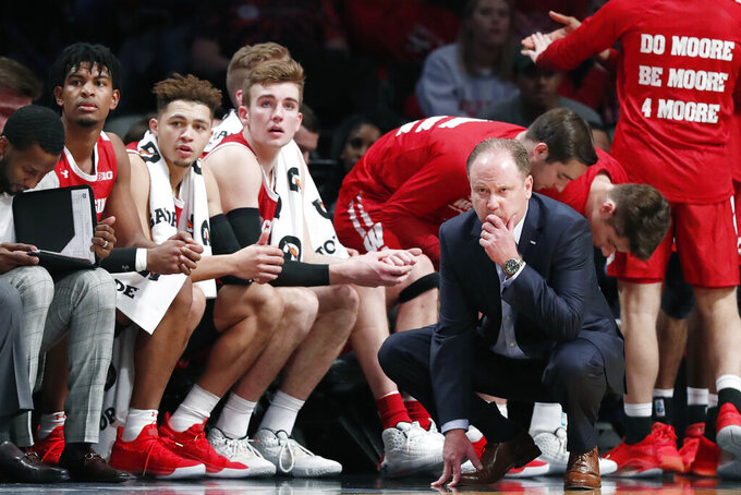 Wisconsin head coach Greg Gard kneels as he watches his team in the second half of an NCAA college basketball game against New Mexico in the Legends Classic, Tuesday, Nov. 26, 2019, in New York. New Mexico defeated Wisconsin 59-50. (AP Photo/Kathy Willens)
