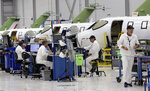 This July 30, 2019 shows several HondaJet aircraft in production at the Honda Aircraft Co. headquarters in Greensboro, N.C. Nearly four years after delivering its first jet, Honda is facing decisions as the company better known for cars and lawnmowers considers whether to sink billions more into its decades-in-the-making aircraft division. (AP Photo/Gerry Broome)