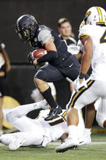 Vanderbilt wide receiver Cam Johnson scores the winning touchdown on a 21-yard pass play against Missouri in the second half of an NCAA college football game Saturday, Oct. 19, 2019, in Nashville, Tenn. Vanderbilt upset Missouri 21-14. (AP Photo/Mark Humphrey)