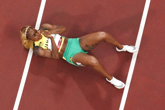 Elaine Thompson-Herah, of Jamaica, wins the gold during the finals of the women's 100-meter at the 2020 Summer Olympics, Saturday, July 31, 2021, in Tokyo. (AP Photo/Morry Gash)