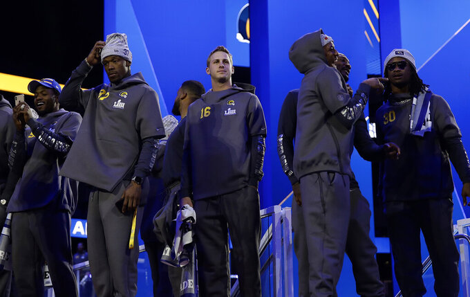 Los Angeles Rams players wait for the start of Opening Night for the NFL Super Bowl 53 football game Monday, Jan. 28, 2019, in Atlanta. (AP Photo/Matt Rourke)