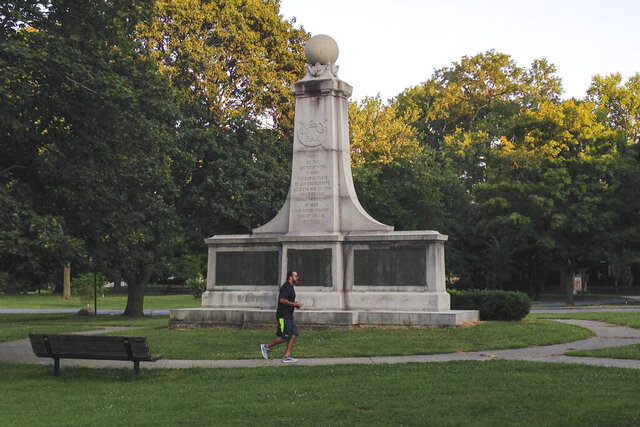File-In this Aug. 15, 2017, file photo, a man runs in Garfield Park of Indianapolis past a monument dedicated to Confederate soldiers who died at a Union prison camp in the city during the Civil War. Mayor Joe Hogsett announced Thursday that the monument would be removed, calling it