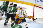 Dallas Stars left wing Roope Hintz (24) with an assist from Dallas Stars center Joe Pavelski (16) scores against the Nashville Predators in the second period during an NHL hockey game, Sunday, Jan. 24, 2021 in Dallas. (AP Photo/Richard W. Rodriguez)