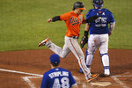 Baltimore Orioles' Austin Hays scores on a double by Jose Iglesias during the eighth inning of the team's baseball game against the Toronto Blue Jays, Saturday, Sept. 26, 2020, in Buffalo, N.Y. (AP Photo/Jeffrey T. Barnes)