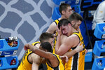 Iowa's Luka Garza (55) hugs a teammate following a second-round game against Oregon in the NCAA men's college basketball tournament at Bankers Life Fieldhouse, Monday, March 22, 2021, in Indianapolis. Oregon won 95-80. (AP Photo/Darron Cummings)