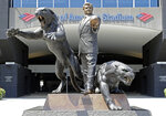 "FILE - In this July 10, 2018, file photo, a statue of former Carolina Panthers owner Jerry Richardson stands outside an entrance to Bank of America Stadium in Charlotte, N.C. The statue of former Carolina Panthers owner Jerry Richardson was removed from in front of the team's stadium, Wednesday, June 10, 2020. ""We were aware of the most recent conversation surrounding the Jerry Richardson statue and are concerned there may be attempts to take it down,"" the team said in a statement. ""We are moving the statue in the interest of public safety."" (AP Photo/Chuck Burton, FIle)"