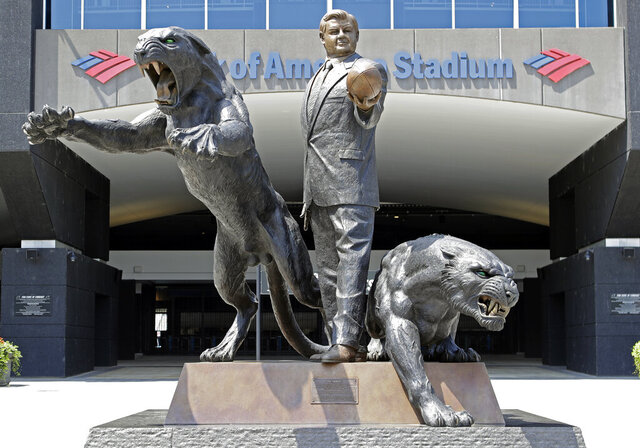 FILE - In this July 10, 2018, file photo, a statue of former Carolina Panthers owner Jerry Richardson stands outside an entrance to Bank of America Stadium in Charlotte, N.C. The statue of former Carolina Panthers owner Jerry Richardson was removed from in front of the team's stadium, Wednesday, June 10, 2020.