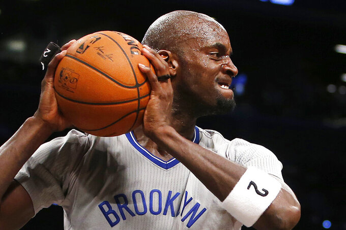 FILE - In this April 11, 2014, file photo, Brooklyn Nets' Kevin Garnett (2) reacts after blocking a shot by Atlanta Hawks' Paul Millsap during the second half of an NBA basketball game in New York. Joining Kobe Bryant as first-time finalists for the Basketball Hall of Fame are: 15-time All-Star Tim Duncan, fellow 15-time All-Star Garnett and 10-time WNBA All-Star and four-time Olympic gold medalist Tamika Catchings.  (AP Photo/Jason DeCrow, File)