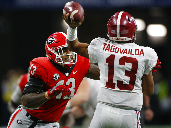 Georgia defensive end Jonathan Ledbetter (13) goes in for a sack on Alabama quarterback Tua Tagovailoa (13) in the second half of the Southeastern Conference Championship game between Georgia and Alabama in Atlanta, Saturday, Dec. 1, 2018. Georgia lost 35-28. (Joshua L. Jones/Athens Banner-Herald via AP)
