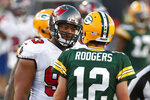 FILE - Tampa Bay Buccaneers defensive end Ndamukong Suh (93) talks with Green Bay Packers quarterback Aaron Rodgers (12) during the second half of an NFL football game in Tampa, Fla., in this Sunday, Oct. 18, 2020, file photo. Rodgers had his worst game of the season in Green Bay's 38-10 loss at Tampa Bay Back on Oct. 18, as he threw two game-changing interceptions and completed less than half his pass attempts. Rodgers gets a chance to make amends for that performance Sunday when the top-seeded Packers host the Bucs in the NFC championship game.  (AP Photo/Jeff Haynes, File)