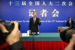 Chinese Foreign Minister Wang Yi arrives for a press conference on the sidelines of the annual meeting of China's National People's Congress (NPC) in Beijing, Friday, March 8, 2019. The U.S.-North Korea summit in Vietnam last week was an