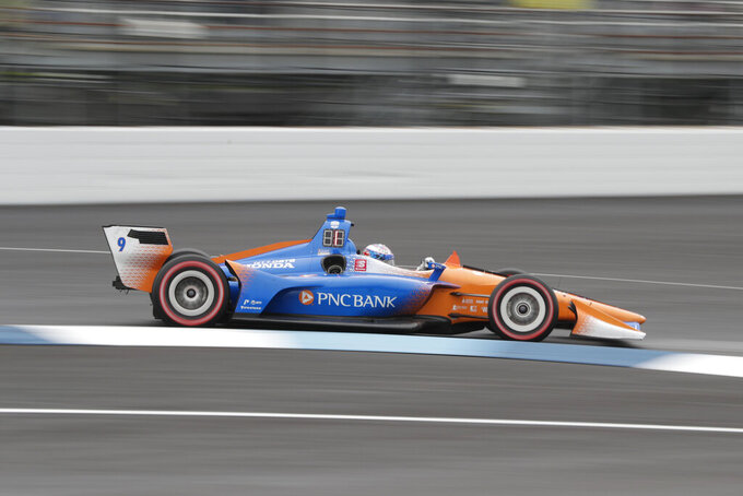 Scott Dixon, of New Zealand, drives through the first turn during the Indy GP IndyCar auto race at Indianapolis Motor Speedway, Saturday, May 11, 2019 in Indianapolis. (AP Photo/Michael Conroy)