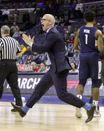 Connecticut coach Dan Hurley runs on the court during the first half of an NCAA college basketball game against Houston at the American Athletic Conference tournament Friday, March 15, 2019, in Memphis, Tenn. (AP Photo/Troy Glasgow)
