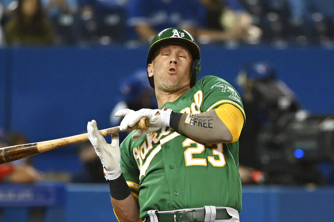 Oakland Athletics' Yan Gomes leans back from an inside pitch thrown by Toronto Blue Jays' Alek Manoah during the fourth inning of a baseball game Friday, Sept. 3, 2021, in Toronto. (Jon Blacker/The Canadian Press via AP