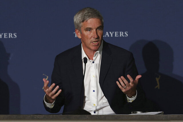 PGA Tour Commissioner Jay Monahan speaks at a news conference at the The Players Championship golf tournament, Thursday, March 12, 2020, in Ponte Vedra Beach, Fla. Monahan announced that the tournament will proceed without fans starting on Friday. The policy will continue through the Valero Texas Open. (AP Photo/Marta Lavandier)
