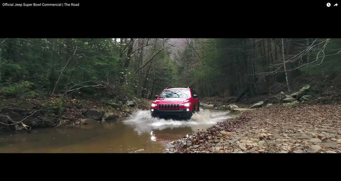 This image made video obtained from the Jeep brand YouTube channel of Fiat Chrysler Automobiles shows part of its commercial video aired during the Super Bowl on Sunday, Feb. 4, 2018. The head of one of the nation's largest fish conservation groups says Fiat Chrysler Super Bowl ads